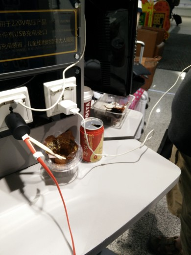 Patrons' food and garbage at a charging station in PEK T2